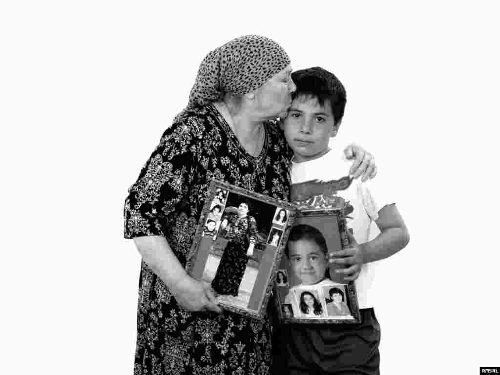 Tamara Shotayeva and her grandson, Georgy Kuchuyev - Tamara lost her daughter Albina and her granddaughter Zarina, who was starting second grade. Tamara's husband, Tsara, couldn't cope with the loss and died soon after of heart failure. During the siege, Tamara was visiting her sick mother in Siberia. Her friends thought she wouldn't be able to bear the news. She suffered from asthma and had already undergone three complicated operations. But it was Tamara who identified the body of her daughter, and who has since become the source of support for the men in her family who survived the tragedy.