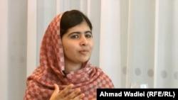 Malala Yousafzai conversing with Abdul Hai Kakar from RFE/RL's Radio Mashaal.