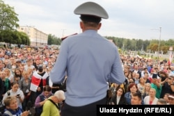A policeman addresses the crowd at a rally in Minsk on August 20.