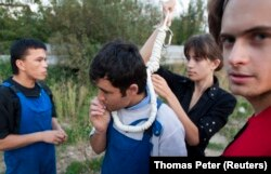 Verzilov (right) and Nadezhda Tolokonnikova prepare a migrant worker for a mock execution in September 2008.