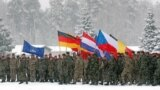 LITHUANIA -- Soldiers hold the country flags of the NATO enhanced Forward Presence (eFP) battle group in Rukla military base, February 4, 2019