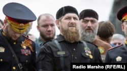 Chechen leader Ramzan Kadyrov (center) is behind a campaign of intimidation that includes instances of torture, humiliation, and even murder, according to Human Rights Watch.