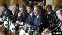 Polish President Bronislaw Komorowski (center) speaks at a summit of Eastern European leaders in Warsaw (*corrected), which U.S. President Barack Obama is due to join later on May 27.