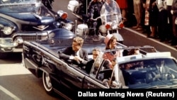 U.S. President John F. Kennedy (left), first lady Jaqueline Kennedy (right), and Texas Governor John Connally ride in a limousine moments before Kennedy was assassinated in Dallas, Texas, on November 22, 1963.