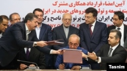 Iran -- (L to R) Thierry Bollore, deputy director of Competitiveness at Renault, Mansour Moazami, Chairman of the Board of Directors of IDRO Group, and Kourosh Morshed Solouk, deputy director of the Iranian Automobile Importers Association, attend a signi