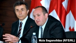 Георгий Маргвелашвили (оңдо) премьер-министр Бидзина Иванишвилинин (солдо) партиясынан көрсөтүлгөн, Тбилиси, 28-октябрь, 2013