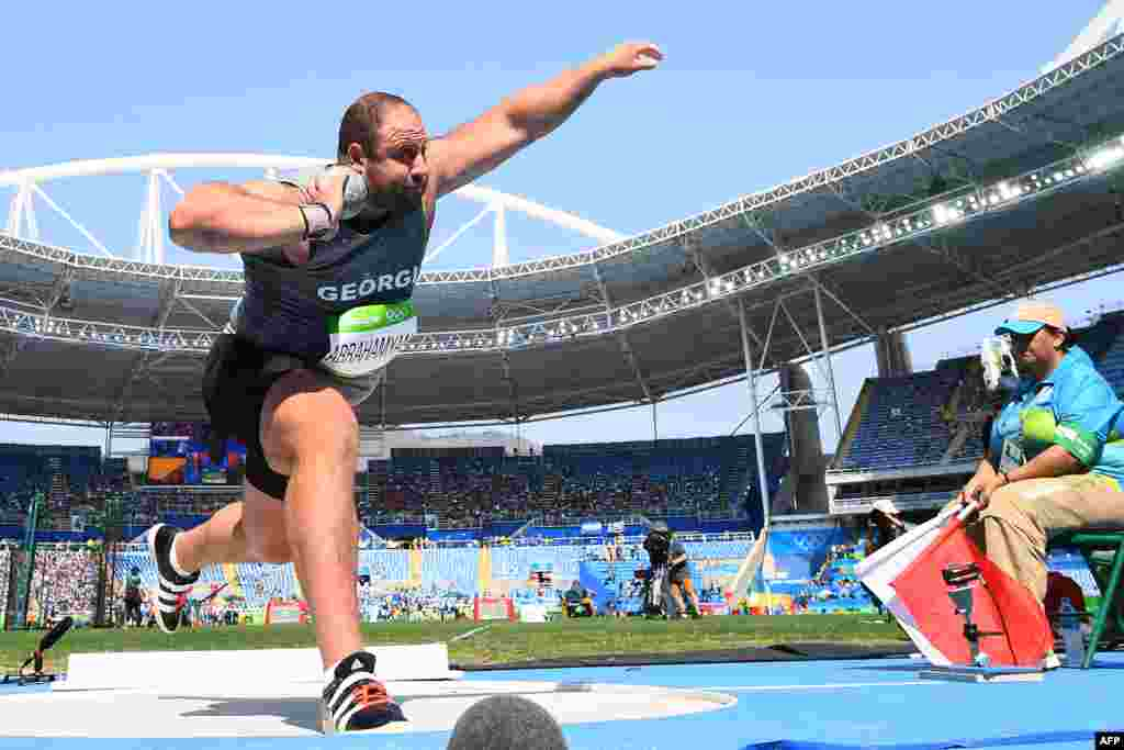 Georgia's Benik Abrahamyan competes in the men's shot put qualifying round.