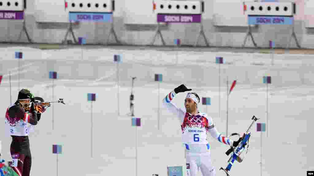 Winner Martin Fourcade of France (right) reacts after the last shooting during the biathlon 12.5-kilometer pursuit competition at Krasnaya Polyana.