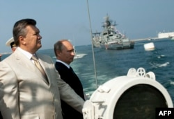 Ukrainian President Viktor Yanukovych and his Russian counterpart, Vladimir Putin, attend a ceremony celebrating Navy Day in Sevastopol on July 28.
