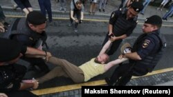 Police detain a participant of a rally in support of Russian investigative journalist Ivan Golunov in Moscow on June 12.