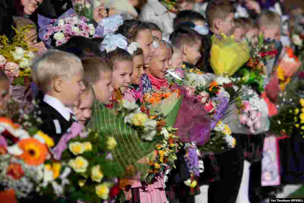 Children and their parents attend the opening ceremony marking the new school year at School No. 1507 in Moscow.