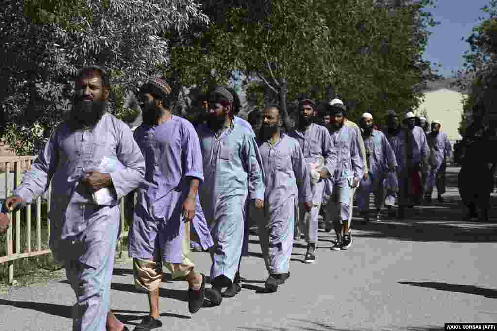 Some of the 100 Taliban prisoners released from the Bagram prison north of Kabul on May 25. The release came amid a three-day cease-fire for the Eid al-Fitr holiday that ends the Muslim holy fasting month of Ramadan. Afghan officials called on the Taliban to extend the cease-fire.