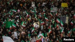 Supporters of Iranian Presidential candidate Ebrahim Raeisi gather during a campaign rally at the Mosalla mosque in Tehran, May 16, 2017
