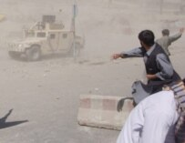 Protesters throw stones at a U.S. military vehicle in Kabul on May 29 (epa)
