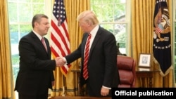 Georgian Prime Minister Giorgi Kvirikashvili (left) meets U.S. President Donald Trump at the White House on May 8.