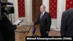 The Russian president emerged in Moscow without his Kyrgyz counterpart but with a canary-eating cat's expression and a piece of advice for all 6-million-plus people in Kyrgyzstan.
