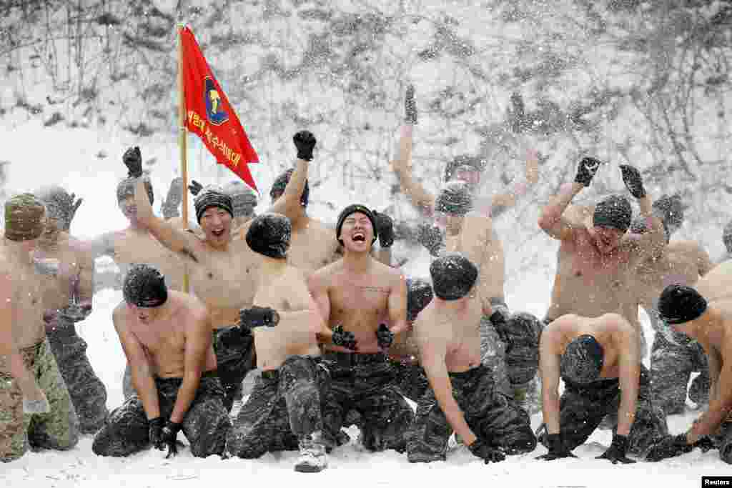 South Korean and U.S. Marines hurl snow during a winter military drill in Pyeongchang, South Korea. (Reuters/Kim Hong-ji)