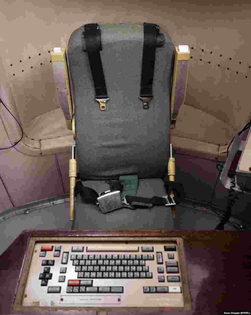 Deep underground, commanders on duty spent six hours in front of their keyboard, strapped into their seats in case an enemy missile struck. The men were not permitted to eat or drink while in this seat.