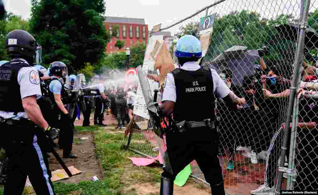 U.S. Park Police officers deploy pepper spray as they clash with protestors during an attempt to pull down the statue of U.S. President Andrew Jackson in the middle of Lafayette Park in front of the White House in the midst of racial inequality protests in Washington, D.C., U.S., June 22, 2020.