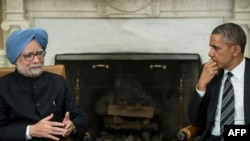 US President Barack Obama and Indian Prime Minister Manmohan Singh hold discussions in the Oval Office of the White House on September 27.