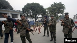Indian security personnel stand guard inside the Indian Air Force (IAF) base Pathankot on January 4.