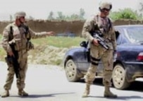 U.S. soldiers control traffic outside Kabul today during the manhunt for the missing detainees