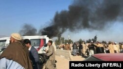 Smoke rises from a bomb blast during a funeral ceremony in Jalalabad on December 31.
