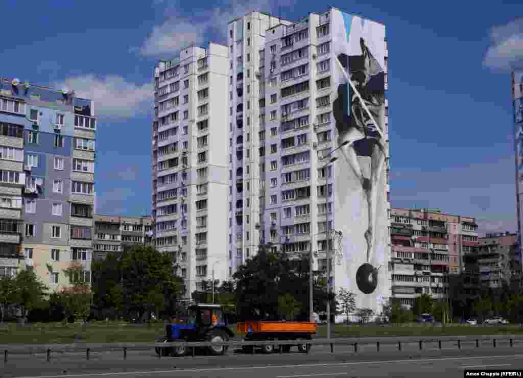 Instability, by Greek artist INO. The 50-meter mural shows a ballerina dancing atop a bomb.