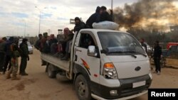 Люди, яких евакуювали зі східної частини Алеппо, 16 грудня 2016 року