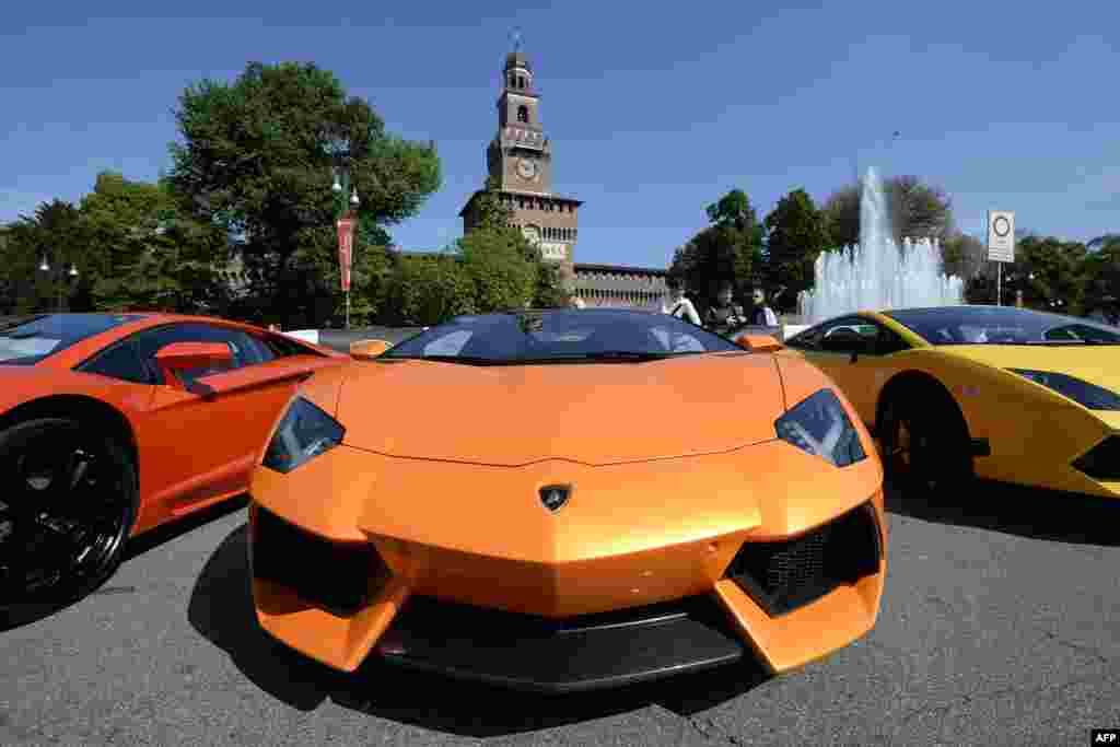 Lamborghini sports cars are parked in front of Milan's Sforza Castle on the eve of the first leg of a 1,200-kilometer grand tour through Italy to mark the 50th anniversary of the carmaker. (AFP/Olivier Morin)