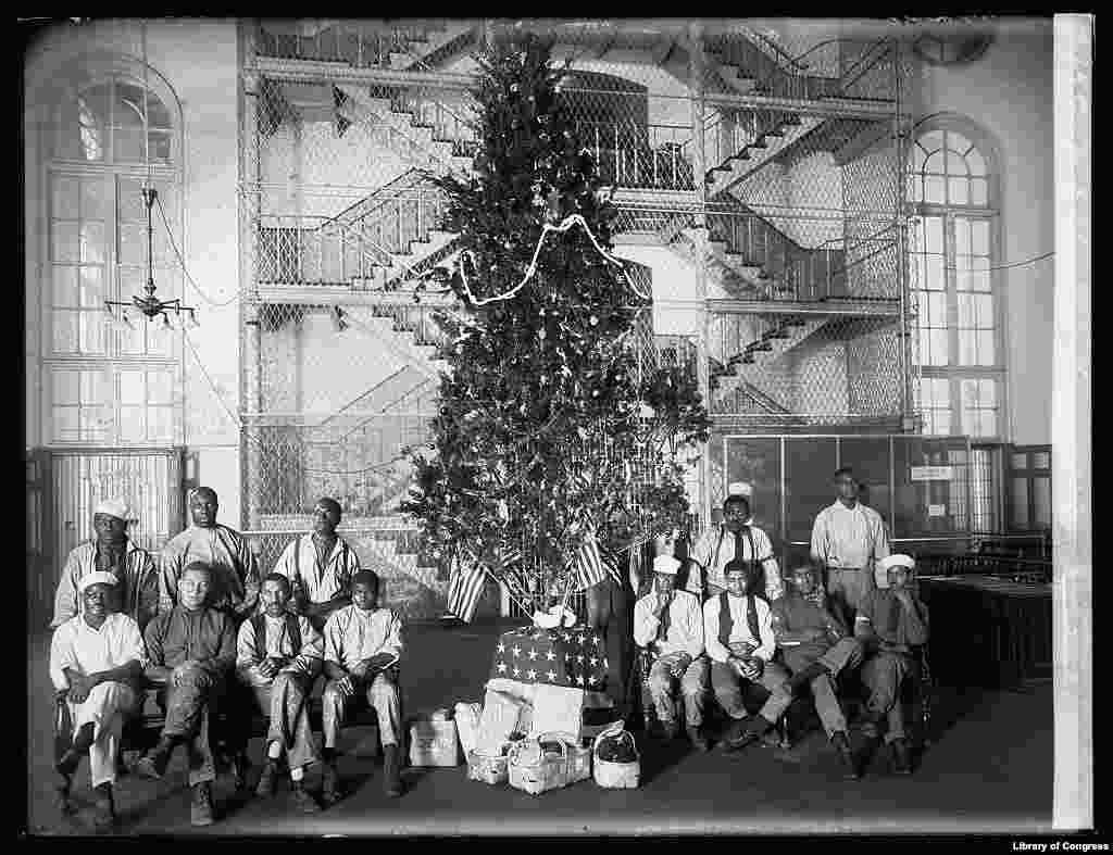 A Christmas tree is seen in what appears to be a U.S. prison.