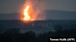 A column of fire is seen after an explosion ripped through Austria's main gas pipeline hub in Baumgarten on December 12.