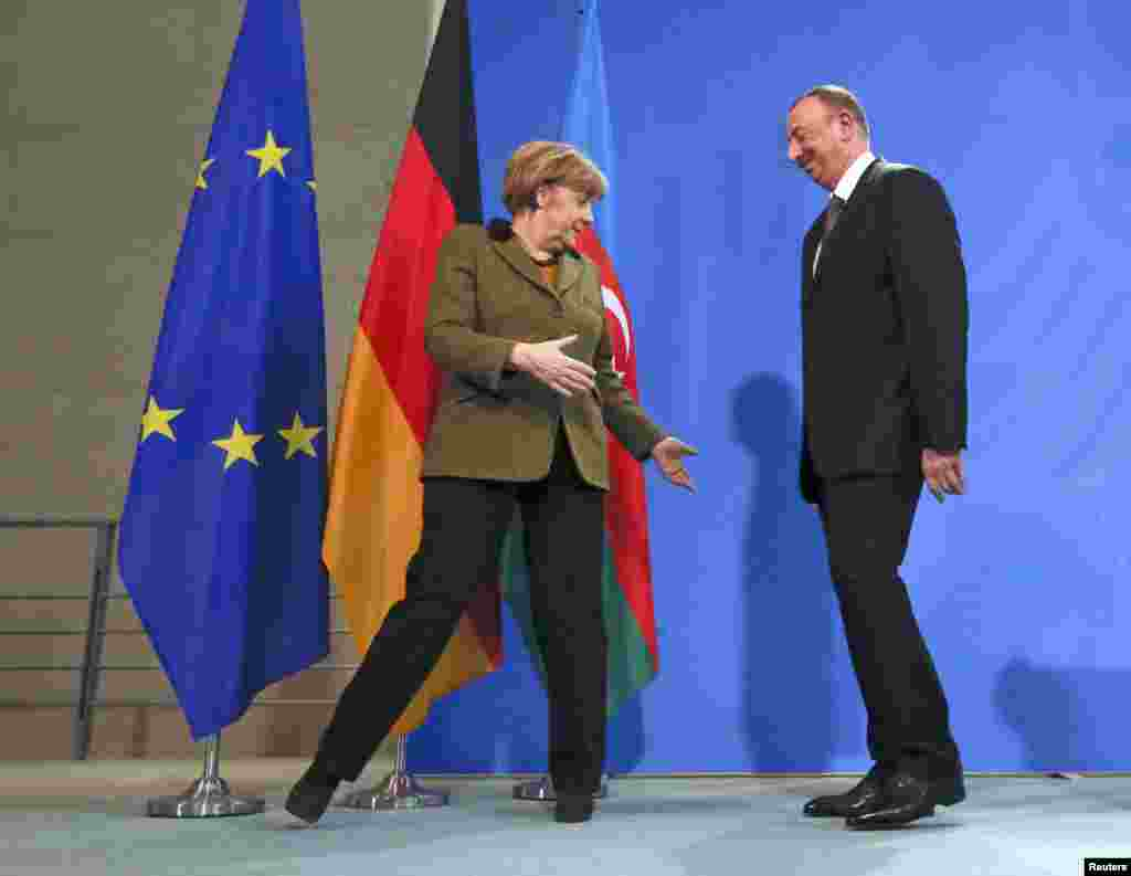 Azerbaijani President Ilham Aliyev and German Chancellor Angela Merkel leave after a news conference at the Chancellery in Berlin. (Reuters/Fabrizio Bensch)