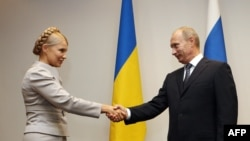 Russian Prime Minister Vladimir Putin and his Ukrainian counterpart, Yulia Tymoshenko meeting in Poland in September.