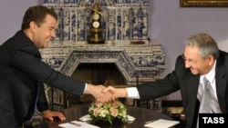 Russian Prime Minister Dmitry Medvedev (left) shakes hands with visiting Cuban leader Raul Castro as they meet in the Gorki residence on July 11.