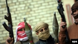 Armed Sunni fighters take up positions in Fallujah on January 5.