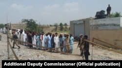 FILE: Voters queued to cast votes in Pakistani general in North Waziristan tribal district on July 25, 2018.