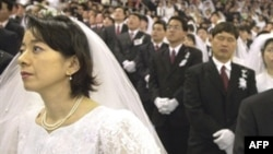 Religious authorities in a number of post-Soviet states, including Russia, have harshly criticized the Unification Church, whose members are seen here in a mass wedding in Seoul in 2002, calling it a sect.