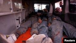 Тіла вбитих афганських військових після нападу 11 березня 2013 року у провінції Вардак