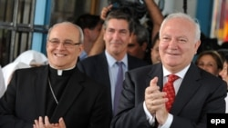 Cuban Cardinal Jaime Ortega (left) and Spanish Foreign Minister Miguel Angel Moratinos welcomed the news.