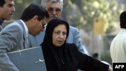 Abdolfattah Soltani (left) speaking with his colleague, the Nobel Prize-winning human rights lawyer Shirin Ebadi, in Tehran in 2004