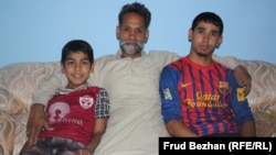 Mohammad Isaq with his sons, Sadiq and Fahim