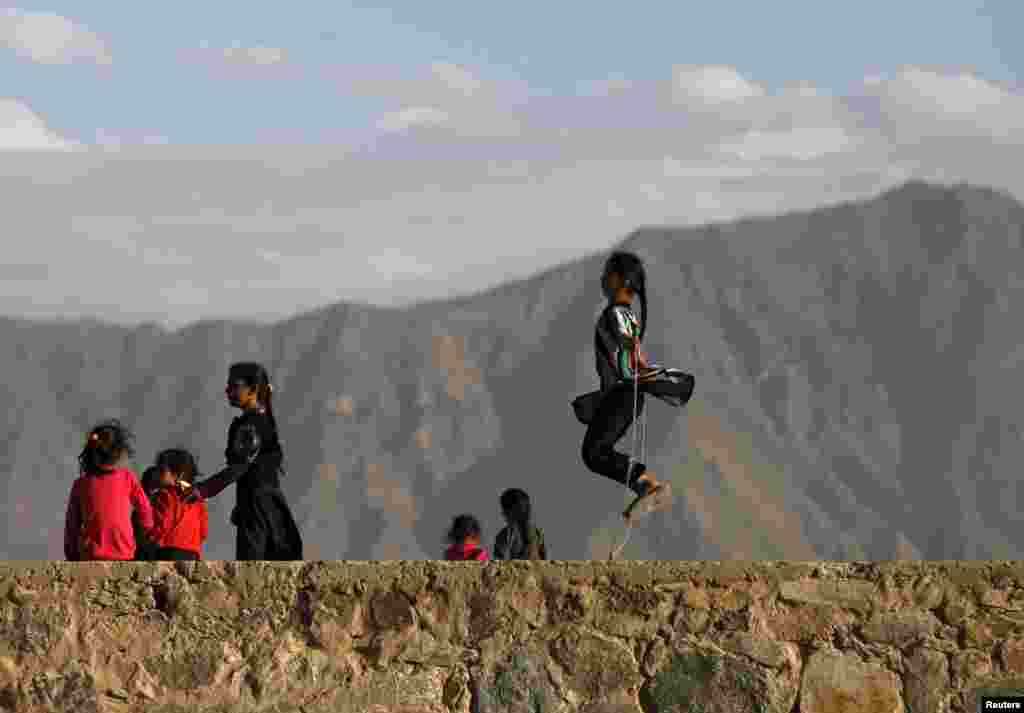 An Afghan girl jumps rope on a hilltop in Kabul. (Reuters/Mohammad Ismail)