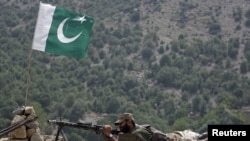 A Pakistani soldier takes up position in Tora Warai, a town in Kurram Agency, earlier this month. Tribal elders were told it was safe to return to the area and that the government was in control.
