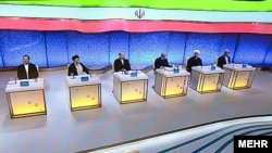 All six approved candidates in Iran's presidential election onstage in Tehran on May 5 for the second of the three live debates. The election is set for May 19.
