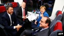 Италия премьер-министрі Маттео Ренци (солдан оңға), Швейцария президенті Йоханн Шнейдер-Амманн, Гермнаия канцлері Ангела Меркель және Франция президенті Франсуа Олланд Готард туннелімен саяхаттап барады. 1 маусым 2016 жыл.