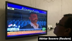 PAKISTAN - A man looks at television screen, airing live transmission of released Indian pilot Wing Commander Abhinandan, at Wagah border, in Karachi, on March 1.