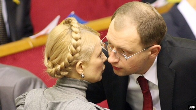 The parties of former Ukrainian Prime Minister Yulia Tymoshenko (left) and ex-parliamentary speaker Arseniy Yatsenyuk are among those which will be joining forces in upcoming elections.