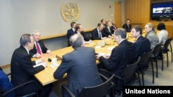 UN Secretary-General Ban Ki-moon (far left) meets with the Middle East Diplomatic Quartet, including several members participating via video link, in New York on March 12.
