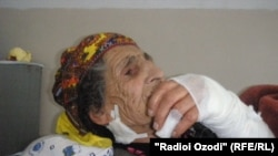 Eighty-nine-year-old Ozodamoh Saidnurulloeva was being attacked by a wolf in her yard before a neighbor scared it away.